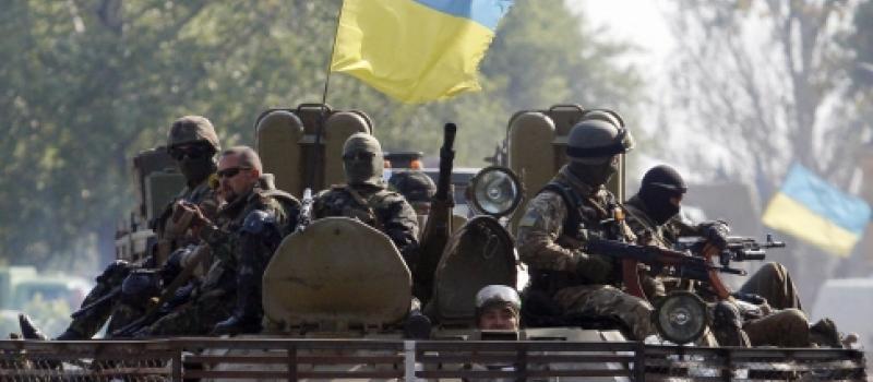 Ukrainian servicemen patrol the Donetsk region in the restive east. Photo: AFP